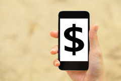 Dollar sign on mobile phone Royalty Free Stock Images