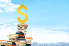 Dollar sign on pile of books Royalty Free Stock Photos