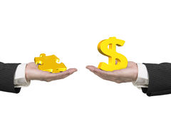 Dollar sign and puzzle piece with two hands Royalty Free Stock Image