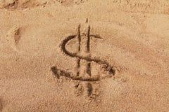 Dollar sign on sand. Dollar sign on wet sand stock image