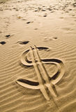 Dollar sign in the sand royalty free stock image