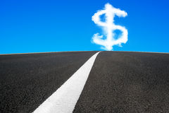 Dollar sign shape cloud in blue sky with asphalt road Stock Image