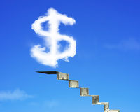 Dollar sign shape cloud with money stairs on blue sky. Background royalty free stock photos
