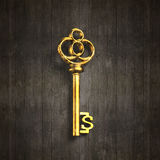 Dollar sign shape golden treasure key. On old dirty wooden background, 3D rendering Stock Images