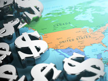 Dollar sign on the world map background with DOF effect. Stock Images