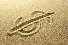 Dollar sign Written in the Sand. Golden colors Stock Photos