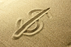 Dollar sign Written in the Sand. Golden colors Royalty Free Stock Photo