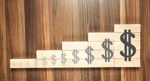 Dollar signs on the wooden blocks royalty free stock photo