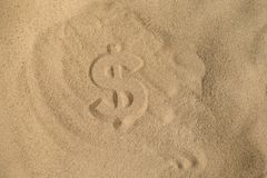 Dollar Silhouette on the sand stock images