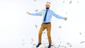Dollar som faller på formellt klädd man i den Santa Claus hatten lager videofilmer