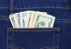 Dollar som klibbar ut ur hans fack Royaltyfri Bild