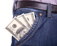 Dollar som klibbar ut ur hans fick- jeansmän Arkivfoto