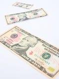 dollar som krymper Arkivbild