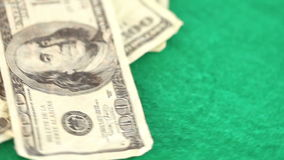 Dollar spinning on a gambling table. Dollar spinning on a green gambling table stock footage