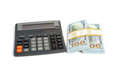 Dollar stack and calculator isolated Stock Photography
