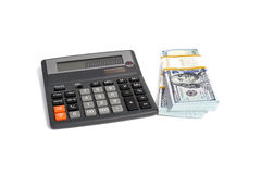 Dollar stack and calculator isolated Royalty Free Stock Photography