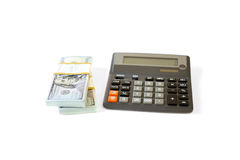 Dollar stack and calculator isolated Royalty Free Stock Photo