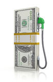 Dollar stack with gas nozzle Royalty Free Stock Photography