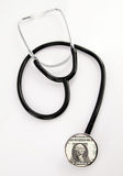 Dollar and stethoscope Royalty Free Stock Images