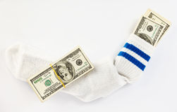 Dollar stock in a sock Royalty Free Stock Images