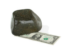 Dollar and stone Royalty Free Stock Images