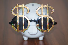 Dollar sunglasses and piggy bank Stock Photography