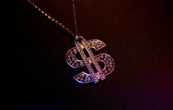 Dollar Symbol. Photo of a Dollar Symbol Necklace With Gel Lighting royalty free stock photo