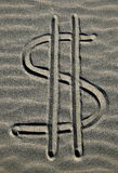 Dollar symbol. Written in the sand stock images