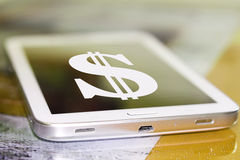 Dollar symbol on the cell phone screen . Royalty Free Stock Images
