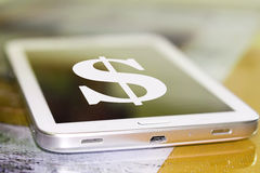 Dollar symbol on the cell phone screen . Stock Photos