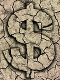 Dollar symbol on cracked earth. Dry cracked earth texture from dry lake with dollar sign symbolizing the Decline and crisis. Photo-montage royalty free stock images