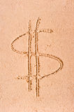Dollar symbol drawn on wet sand Stock Photo