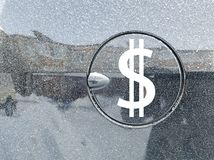 Dollar symbol on the gas car. The dollar symbol on the gas car royalty free stock images