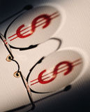 Dollar symbol on glasses Stock Photo