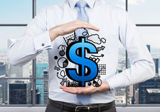Dollar symbol with graphs in hand Stock Photos