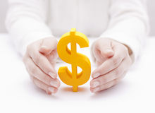 Dollar symbol protected by hands Royalty Free Stock Images