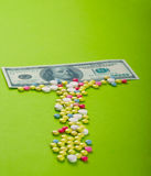 Dollar with tablets. Pills and tablets with US dollar Royalty Free Stock Images