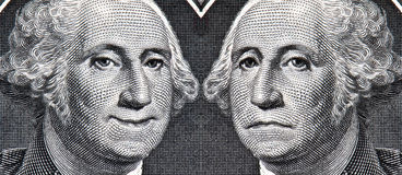 The Dollar Then And Now. George Washington on dollar bill with a happy face and sad face representing how the economy used to be and how it is now Stock Photos