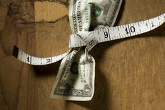 Dollar Tied with Measuring Tape Royalty Free Stock Photography
