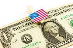 Dollar and U.S. flag Royalty Free Stock Photos