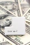 Dollar und eine ENTER-Taste Stockfotos