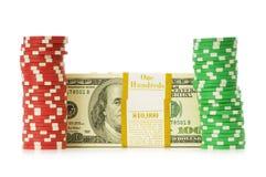 Dollar- und Kasinochip-Stapel Stockbild