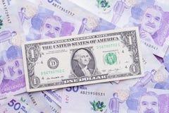 Dollar und kolumbianischer Peso Lizenzfreies Stockfoto