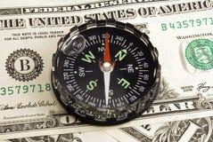 Dollar und Kompaß Lizenzfreies Stockfoto