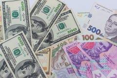Dollar und neues ukrainisches hryvnia Stockfotos