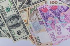 Dollar und neues ukrainisches hryvnia Stockfoto