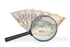 Dollar und Vergrößerungsglas Stockfotos