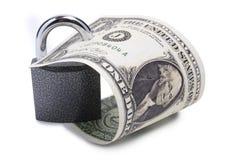 Dollar und Verschluss auf einem Weiß Stockfotos