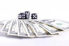 Dollar und würfelt Stockfoto