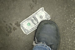 Dollar Under Foot Stock Photography